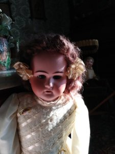 creepy lighting doll