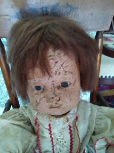 doll with cracked face